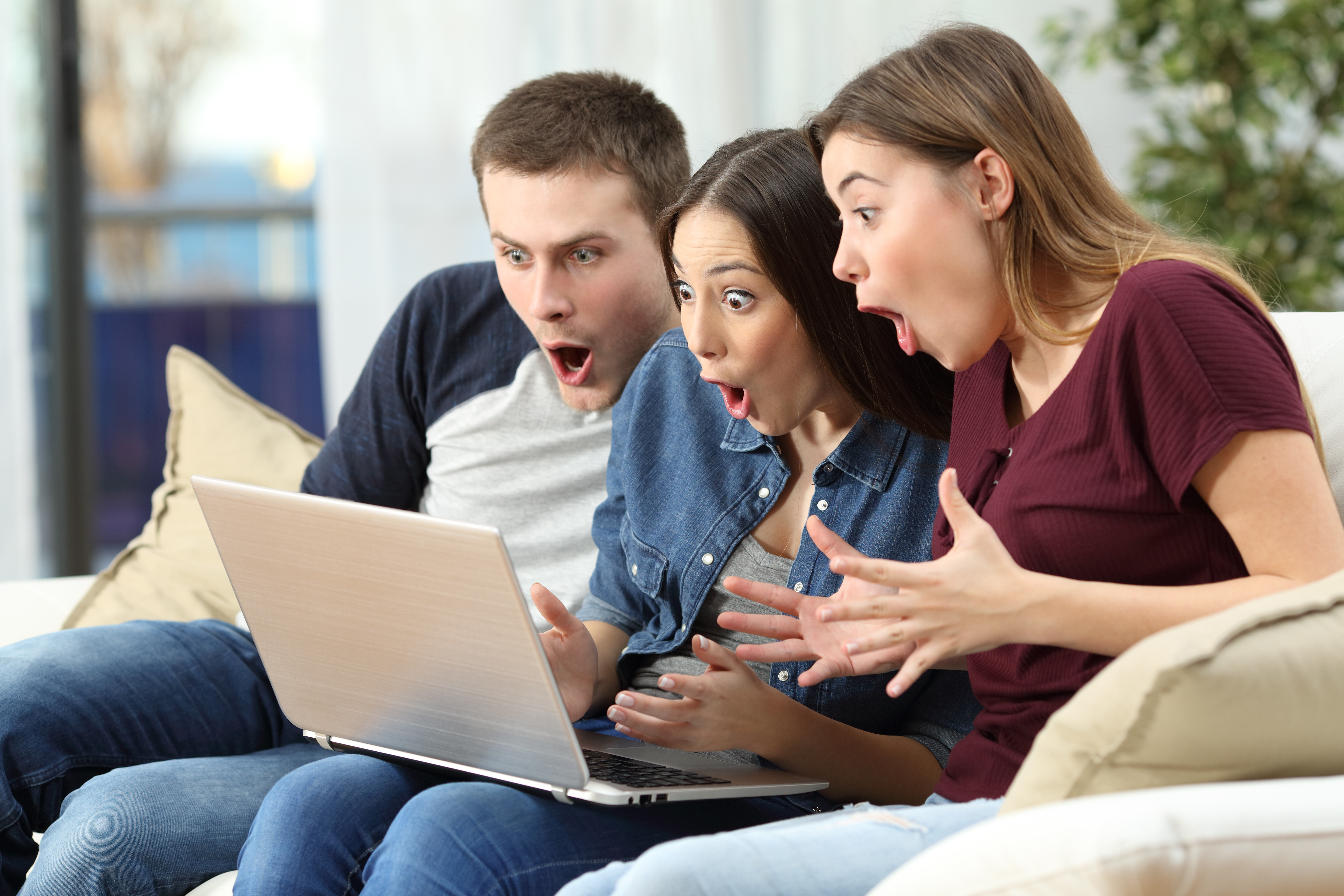 friends looking at at content on computer, amazed faces
