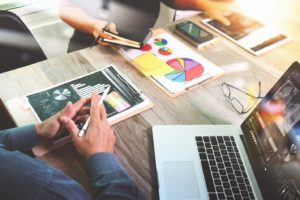 digital marketing strategy at an office, graphs and data