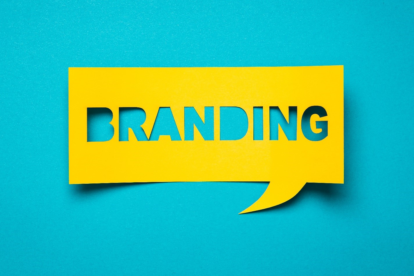 "the word ""Branding"" cut out of yellow paper"