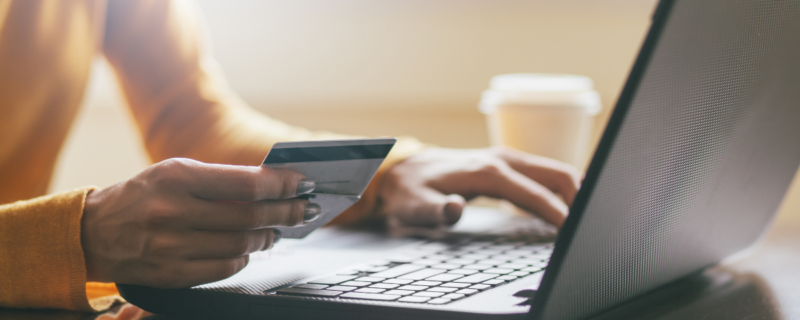 A person using their credit card to make an online purchase