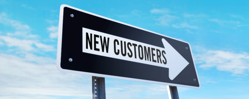 Sign with an arrow that says new customers